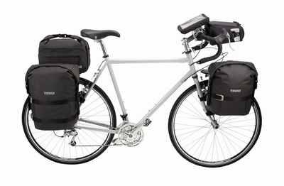 Mountainbike Gepäck Transport - soviel würde ich mir nicht mitnehmen, aber so siehst du, die unterschiedlichen Möglichkeiten an MTB Gepäckträger Modellen, Bild: Thule